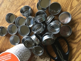 All the lids, with our scissors and twine.